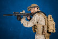 Modern soldier in uniform with rifle Stock Photo