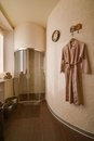 Modern spa center interior room with shower cabin and bathrobe Royalty Free Stock Photo