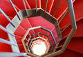 Modern spiral staircase with red carpet Royalty Free Stock Photo