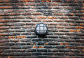 Modern street electric lamp on the old brick wall Royalty Free Stock Photo