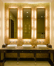 Modern style interior design of a bathroom view decorative gold mirror frame and lavatory in Royalty Free Stock Photos