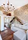 Modern style two-high living-room interior with staircase