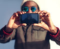 Modern stylish african man makes selfie, screen front view Royalty Free Stock Photo