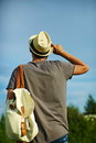 Modern stylish man in casual cloth in hat back of young attractive glasses behind blue sky Stock Photo