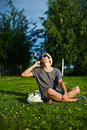 Modern stylish man in casual cloth in hat portrait of young attractive smiling glasses the park Royalty Free Stock Photo