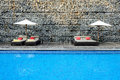 Modern Swimming Pool with stone wall Royalty Free Stock Photo