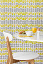 Modern table and chair on bright background breakfast floral Royalty Free Stock Photography