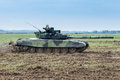 Modern tank on battle field during speed pass Royalty Free Stock Photo
