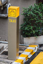 Modern taxi stand in urban area Stock Image