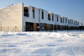 Modern terraced family houses with a balcony just built covered by fresh snow Stock Image