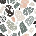 Modern terrazzo texture. Seamless pattern with colored stone fractions or pieces scattered on white background. Creative