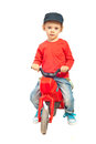 Modern toddler with bike boy riding toy isolated on white background Royalty Free Stock Photography