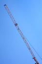 Modern tower crane against blue sky. Royalty Free Stock Photo
