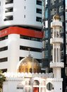Modern and traditional religous architecture in abu dhabi small white mosque with golden color dome nice minaret with ornaments Royalty Free Stock Photos