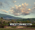 Modern train high speed passing trough landscape Stock Image