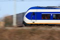 Modern train in motion a dutch moving past Royalty Free Stock Images