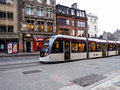 Modern tram serviced in edinburgh old town united kingdom april for public transportation s and new Royalty Free Stock Images
