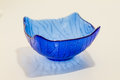 Modern translucent blue glass dish or bowl Royalty Free Stock Photo