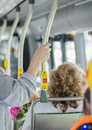 Modern urban bus interior with passengers Stock Photography