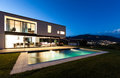 Modern villa with pool night scene Stock Photography