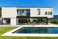 Modern villa with pool view from the garden Stock Image