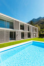 Modern villa with pool view from the garden Royalty Free Stock Photo