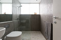 Modern walk in shower with mosaic full height tiles Royalty Free Stock Photo