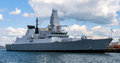 A modern warship in Portsmouth harbour Royalty Free Stock Photo