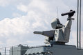 Modern weapons on the deck of a military ship. Weapon system for defense Royalty Free Stock Photo
