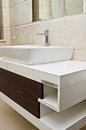 Modern white bathroom sink and cabinet closeup of Royalty Free Stock Photos