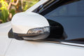 Modern white car side view mirror folded Royalty Free Stock Photo