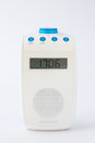 Modern white radio front view of an isolated blue and of bathroom Royalty Free Stock Images