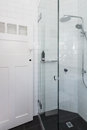 Modern white shower in bathroom renovation with brick pattern ti Royalty Free Stock Photo