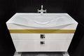Modern White Vanity Basin Unit In Black Tiled Washroom Royalty Free Stock Photo