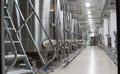 Modern wine factory with large tanks for the fermentation Royalty Free Stock Photo