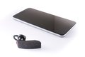 Modern wireless bluetooth headset and smartphone Royalty Free Stock Photo