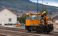 Modern yellow support motor rail car stands on the railway in norway Royalty Free Stock Images