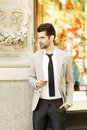 Modern young businessman portrait confident standing on street business people Stock Image