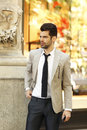 Modern young businessman portrait confident standing on street business people Royalty Free Stock Photo