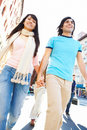 Modern young couple walking down the street Stock Photo