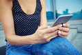 A modern young girl checking email via smart phone Royalty Free Stock Photo