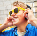 Modern young guy listening to  music Royalty Free Stock Photography