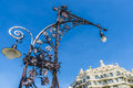 Modernist style streetlight and la pedrera barcelona view of casa mila better known as designed by antoni gaudi a on the passeig Stock Photo