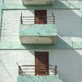 Modest balconies and railings of a low income apartment building Stock Images