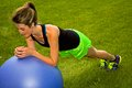 Modified plank with an exercise ball young woman doing the Royalty Free Stock Photography