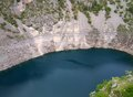 Modro jezero blue lake called near imotski town in croatia Stock Photo