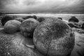 Moeraki boulders on the koekohe beach eastern coast of new zealand hdr image black and white Royalty Free Stock Photos