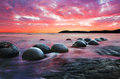 Moeraki boulders on the koekohe beach eastern coast of new zealand sunset and long exposure Stock Photography