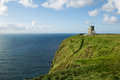 Moher cliffs the tower on the of ireland Stock Photo