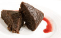 Moist chocolate cake with cherry sauce two slices of Stock Photo